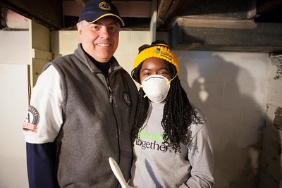 Director of AmeriCorps Bill Basl and AmeriCorps member serving on MLK Day 2014. Corporation for Photo by Henry Scott.
