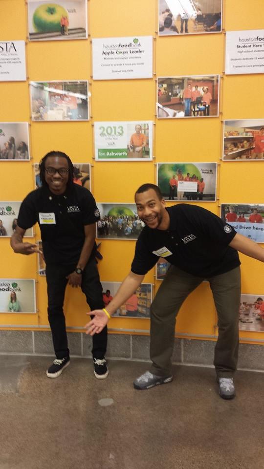 VISTA members William Fleming and Aarik Mickens-Dessaso at the Houston Food Bank