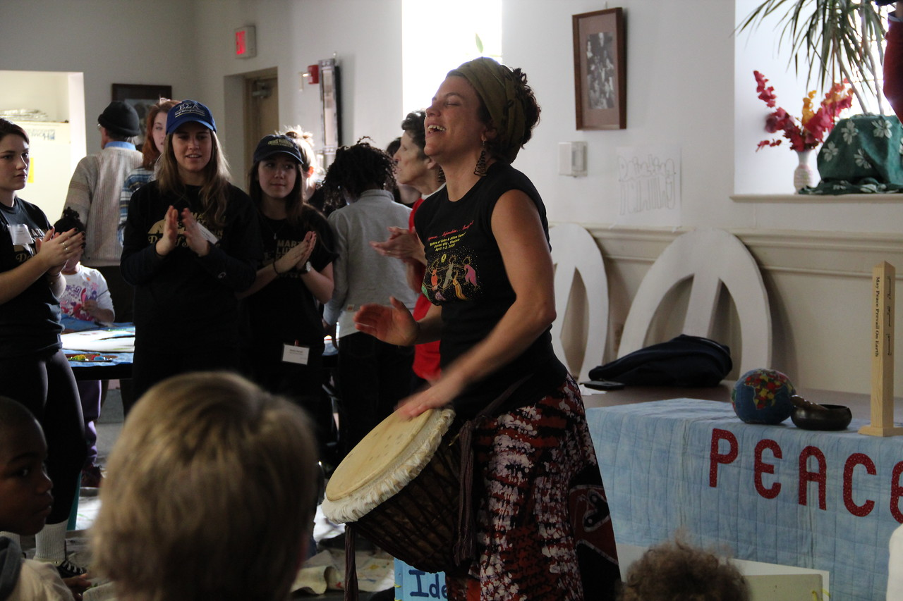 "The ""Drum Lady"" leads a rhythmic song for peace on MLK Day 2014. Corporation for National and Community Service Photo."
