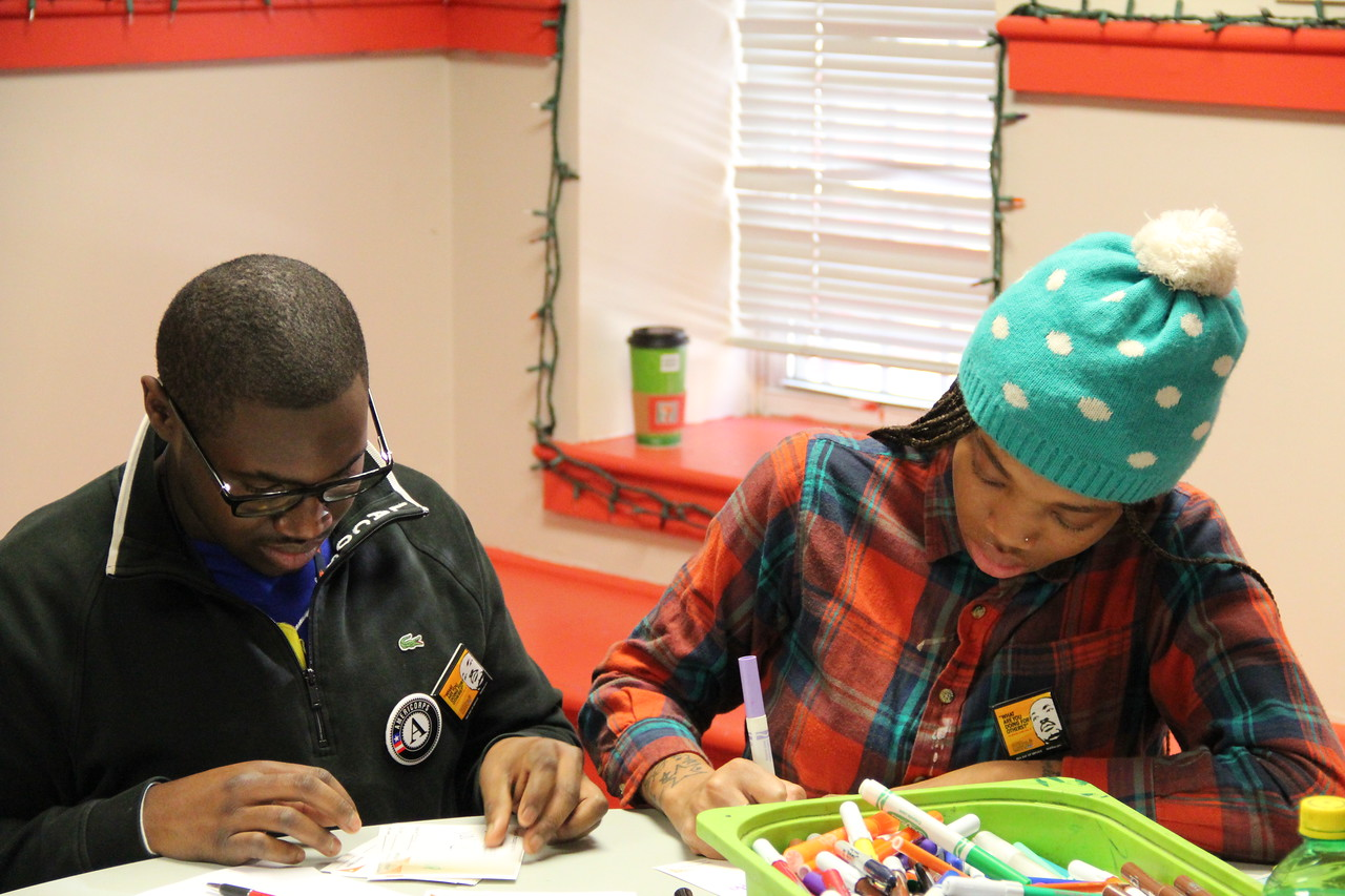 Volunteers write goodwill messages to accompany hygiene kits for homeless youth at the Latin American Youth Center in Washington, D.C. on MLK Day 2014. Corporation for National and Community Service Photo.