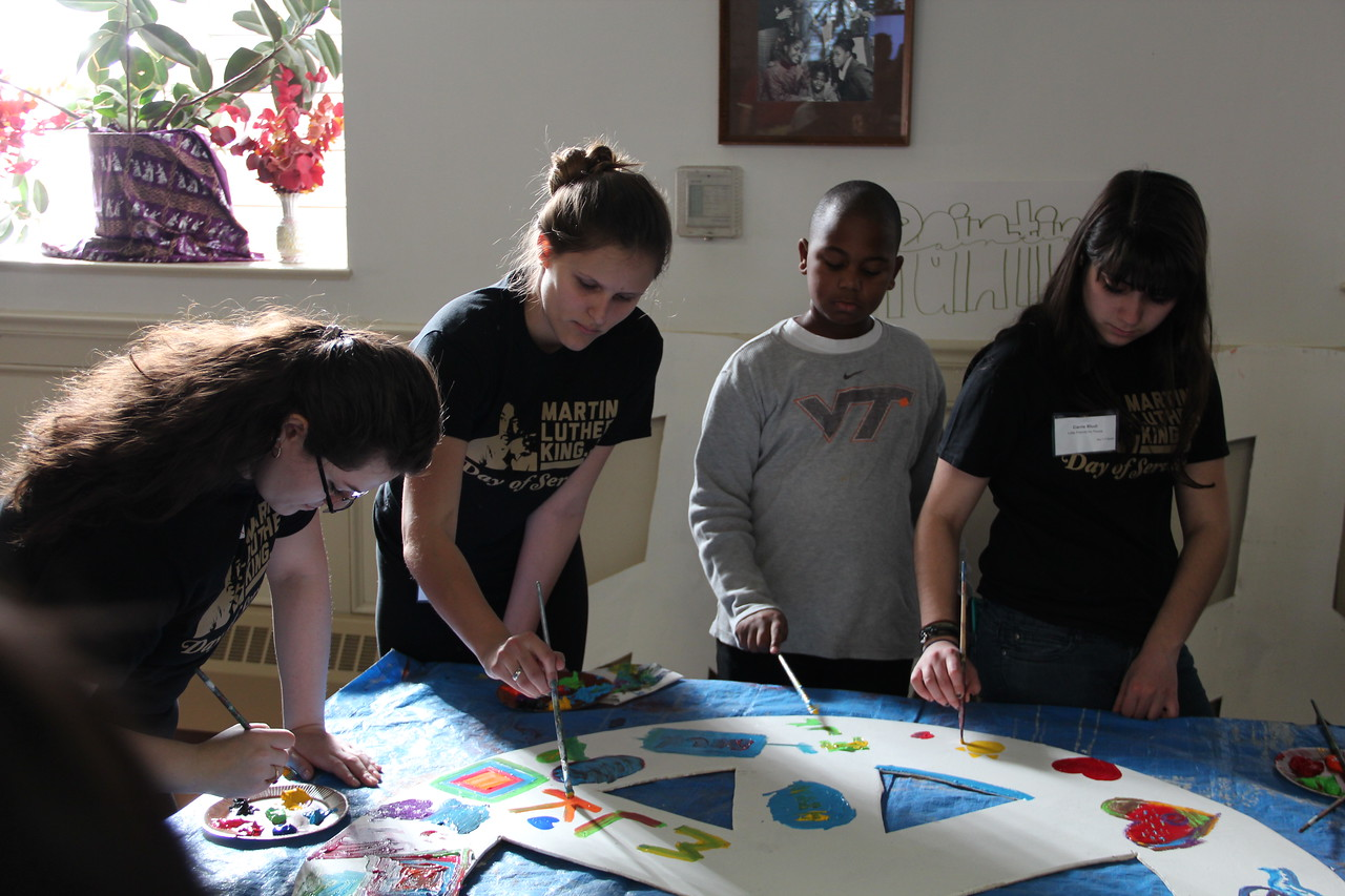 Volunteers paint a large peace sign on MLK Day 2014. Corporation for National and Community Service Photo.