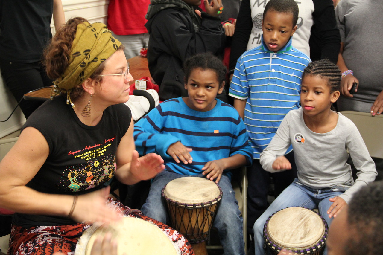 "The ""Drum Lady"" teaches young students a rhythmic song for peace on MLK Day 2014. Corporation for National and Community Service Photo."