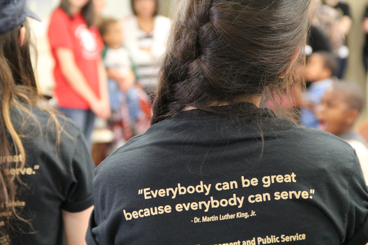 """Everybody can be great because everybody can serve."" A volunteer wears a shirt featuring a quote from Martin Luther King, Jr. on MLK Day 2014. Corporation for National and Community Service Photo."