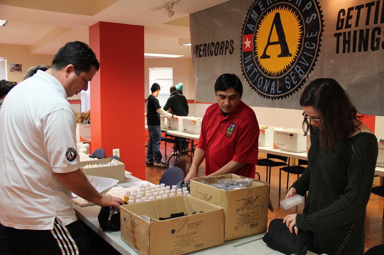 An AmeriCorps program coordinator and community volunteers prepare hygiene kits for homeless youth at the Latin American Youth Center in Washington, D.C. on MLK Day 2014. Corporation for National and Community Service Photo.