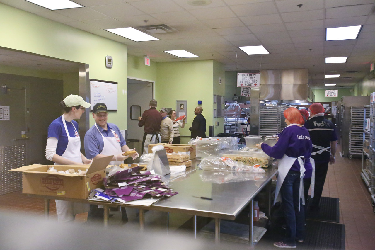 Volunteers from FedEx prepare food at Food and Friends in NE Washington, D.C. during MLK Day 2014. Corporation for National and Community Service Photo.