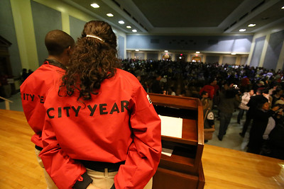 City Year AmeriCorps members speaks to volunteers at Coolidge HS in Washington, D.C. before the service event for MLK Day 2014. Corporation for National and Community Service Photo.
