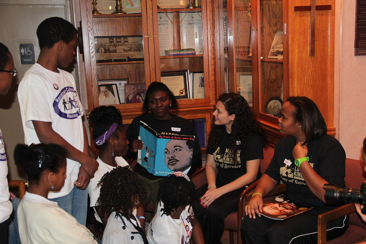 Volunteers read to young students about Martin Luther King, Jr. on MLK Day 2014. Corporation for National and Community Service Photo.
