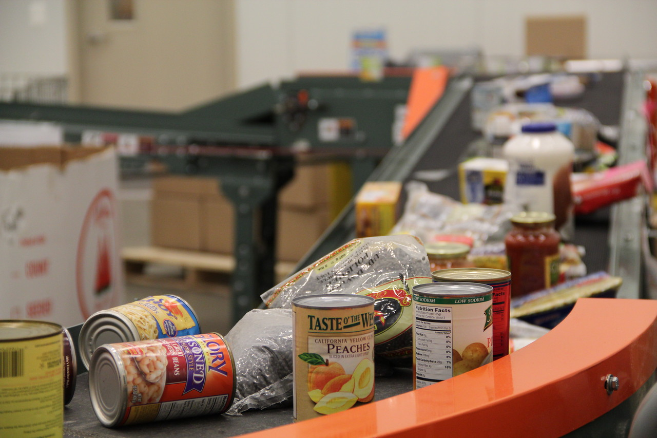 Food awaits sorting on a conveyor belt at the Capital Area Food Bank on MLK Day 2014. Corporation for National and Community Service Photo.