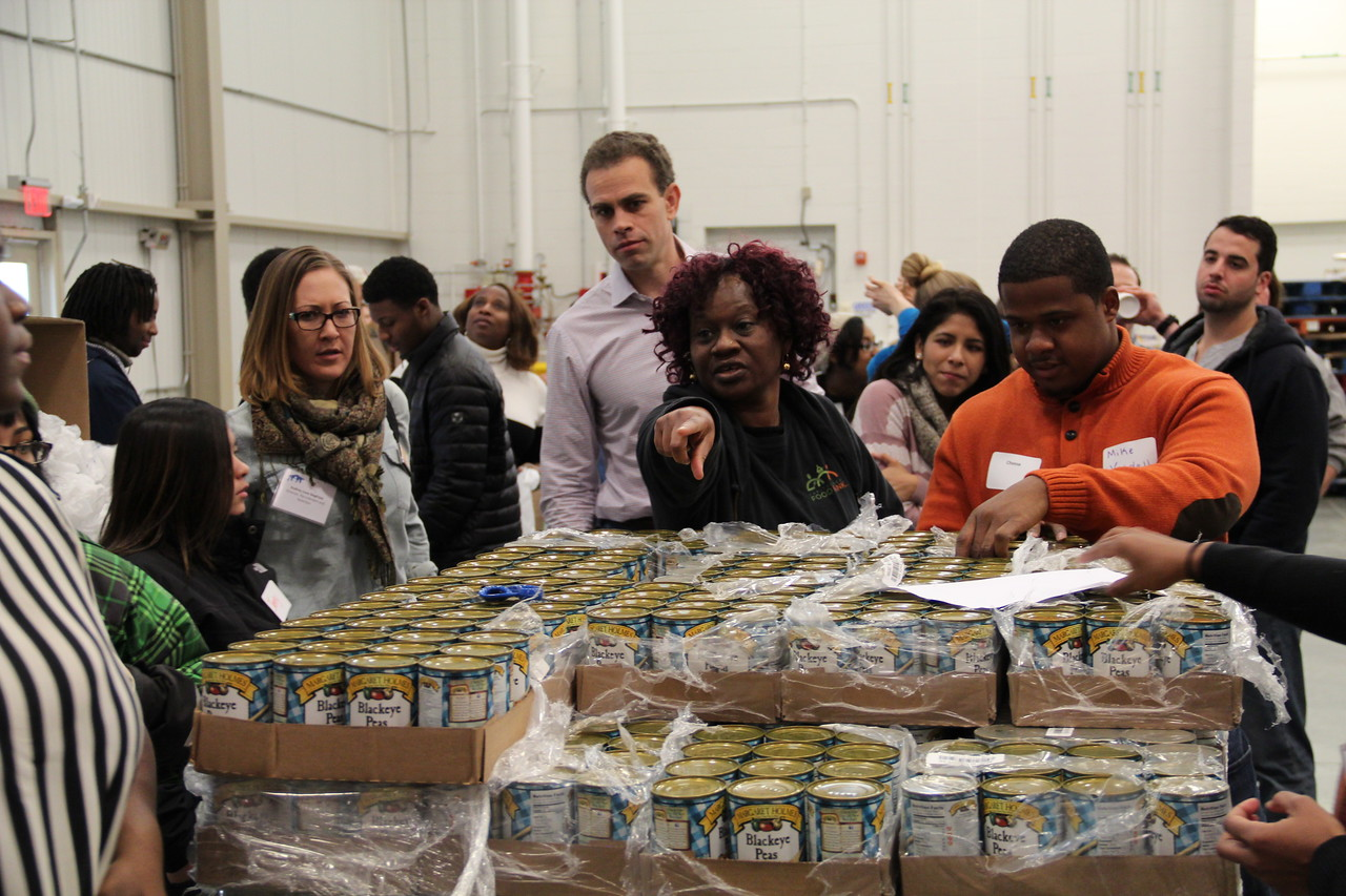 A leader at the Capital Area Food Bank directs volunteers as they prepare 2,000 emergency lunches on MLK Day 2014. Corporation for National and Community Service Photo.