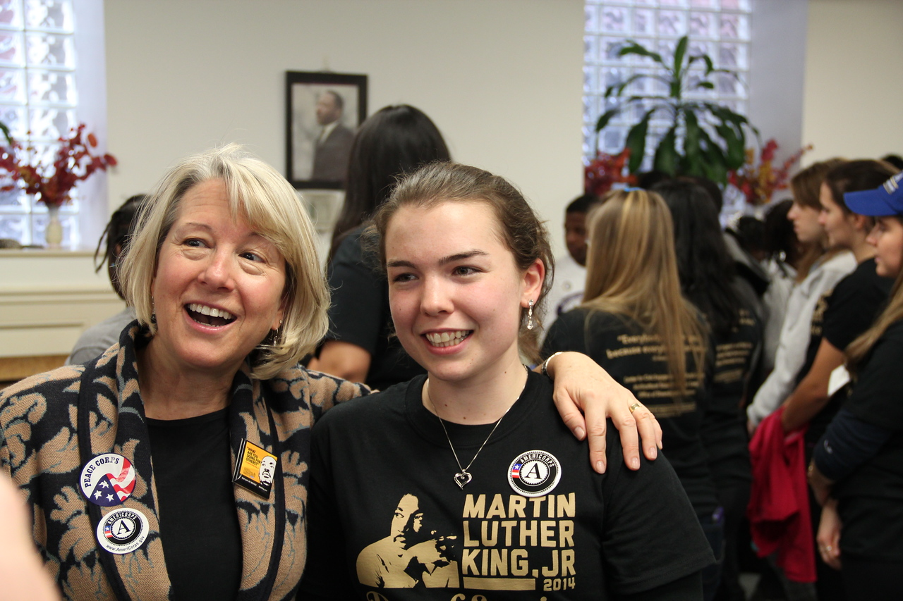 Acting Director of the Peace Corps Carrie Hessler-Radelet poses with an AmeriCorps VISTA member on MLK Day 2014. Corporation for National and Community Service Photo.