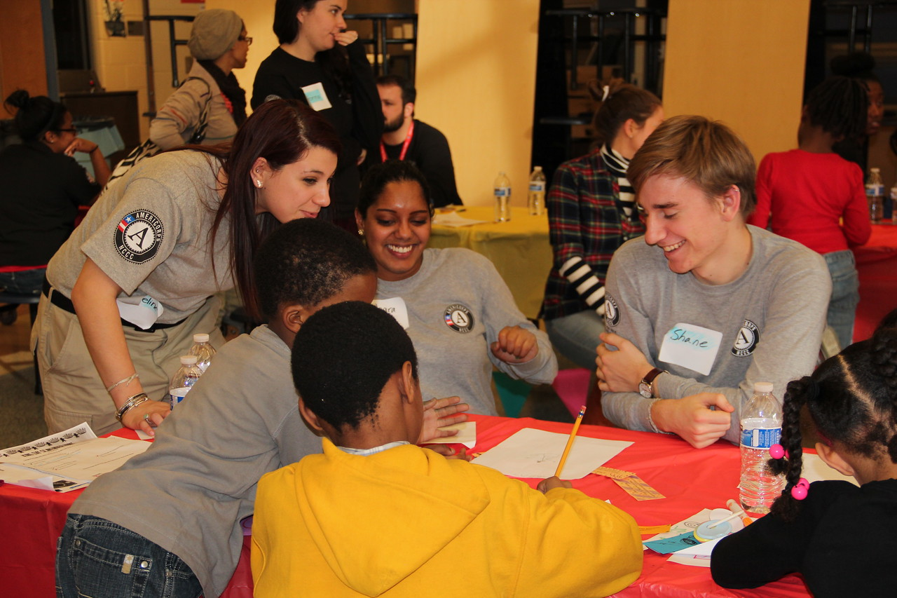 AmeriCorps NCCC members help young students on MLK Day 2014. Corporation for National and Community Service Photo.