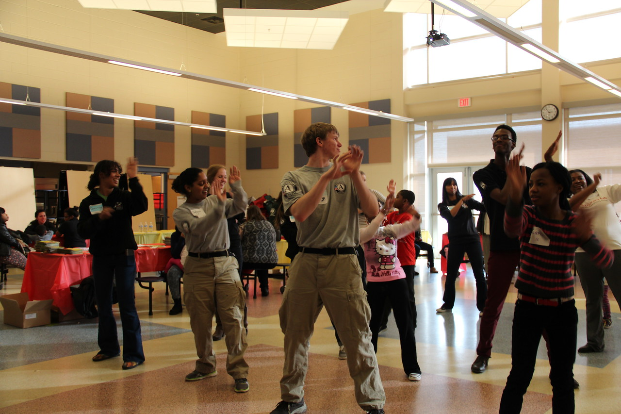 AmeriCorps members lead children and community members in a line dance on MLK Day 2014. Corporation for National and Community Service Photo.