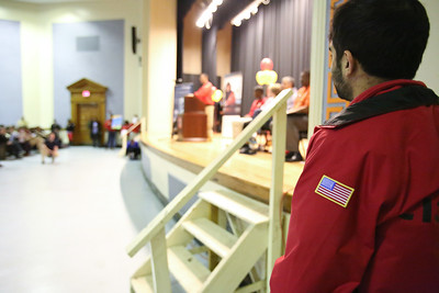 A City Year AmeriCorps member listens as speakers talk to the crowd of volunteers at Coolidge HS in Washington, D.C. before the service event during MLK Day 2014. Corporation for National and Community Service Photo.
