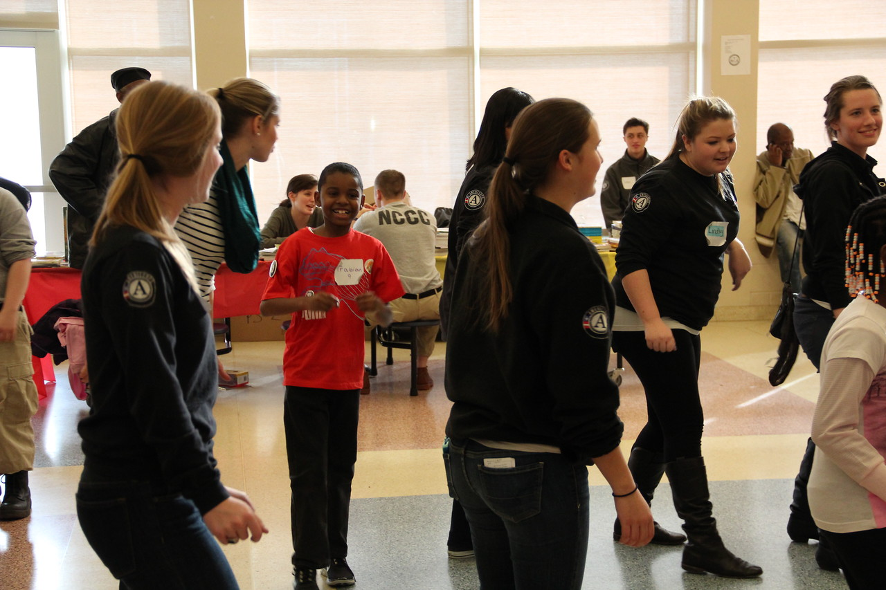 AmeriCorps members with Metro DC Reading Corps lead children in a line dance at a community event on MLK Day 2014. Corporation for National and Community Service Photo.