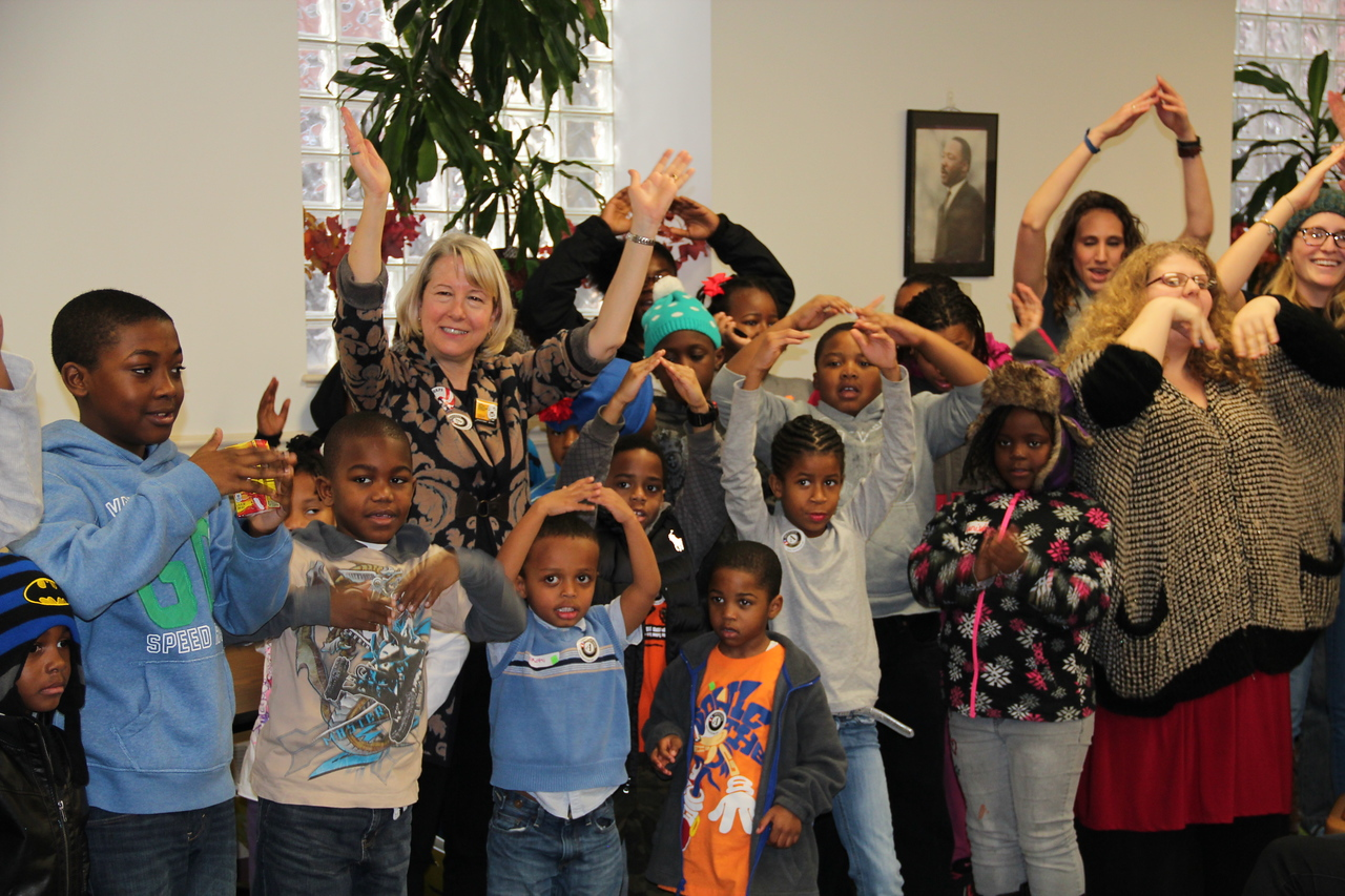 "Acting Director of Peace Corps Carrie Hessler-Radelet and a group of young children recite the ""Peace Pledge"" on MLK Day 2014. Corporation for National and Community Service Photo."