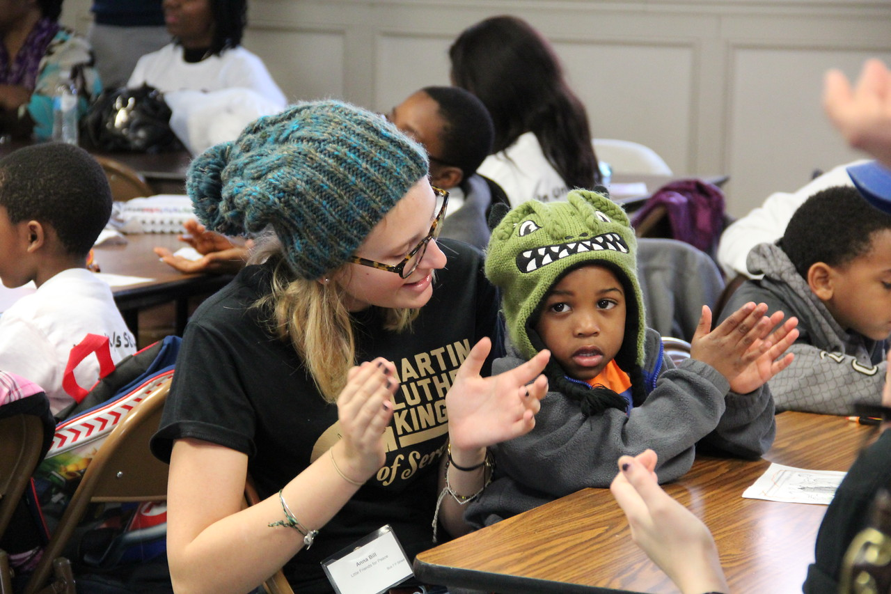 A volunteer and young child clap along to a song for peace on MLK Day 2014. Corporation for National and Community Service Photo.