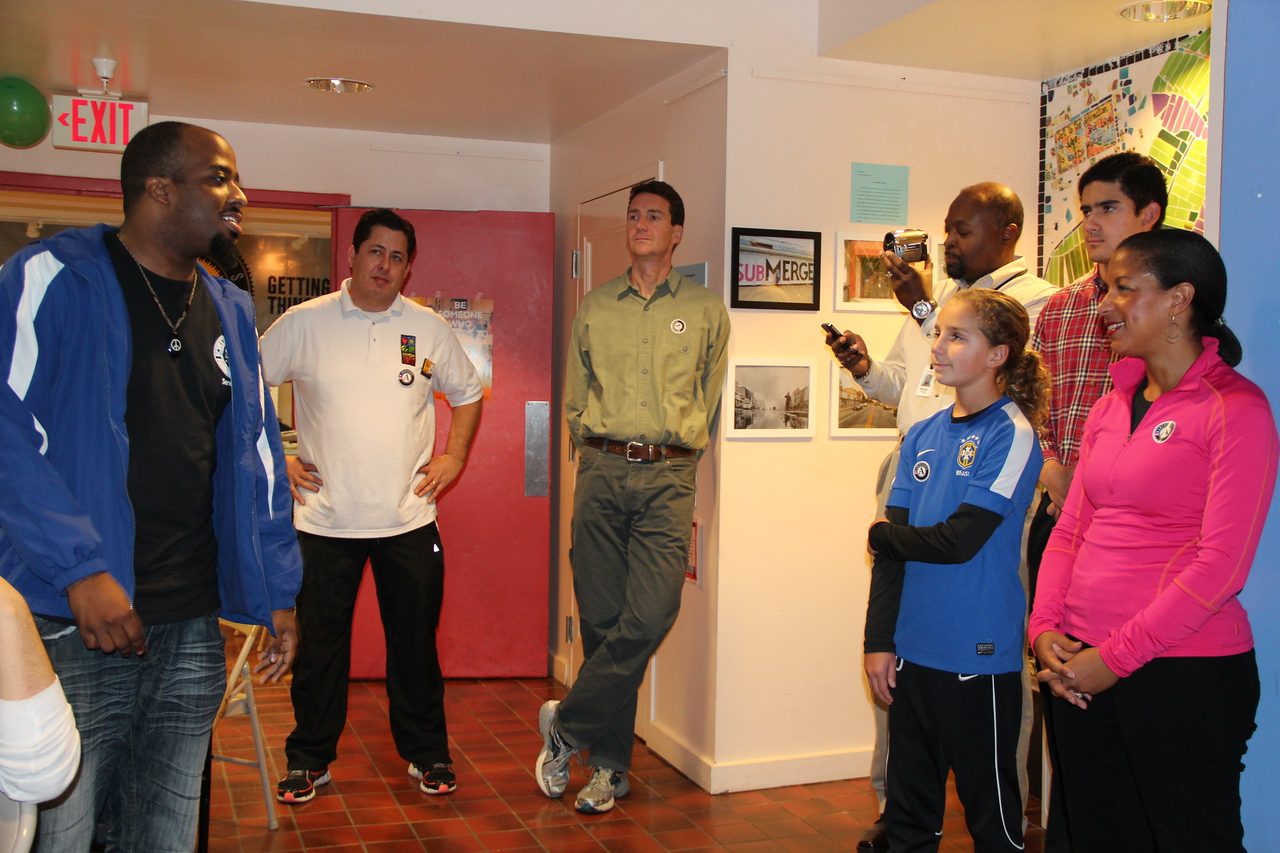 An AmeriCorps member shares his story with United States National Security Advisor Susan Rice at the Latin American Youth Center in Washington, D.C. on MLK Day 2014. Corporation for National and Community Service Photo.