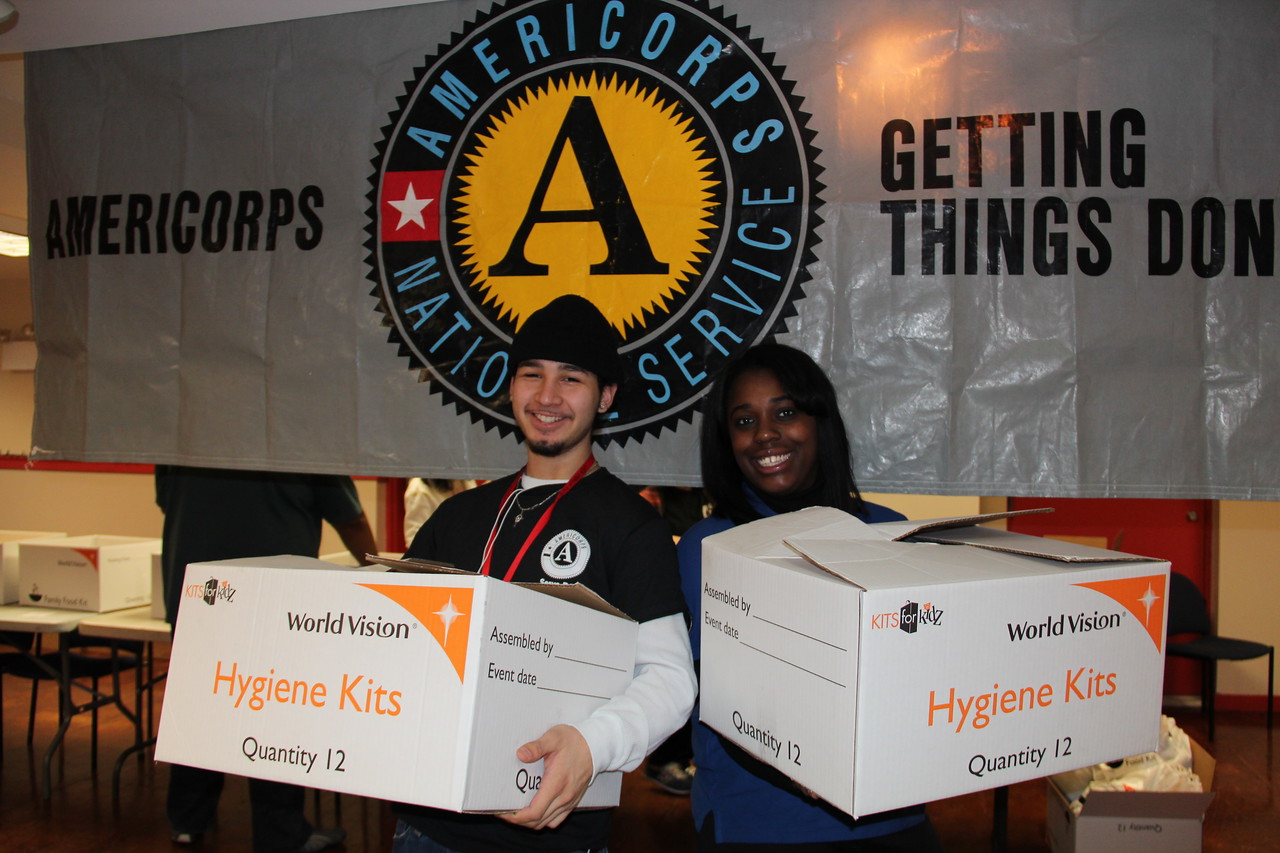 AmeriCorps members proudly display boxes of hygiene kits for homeless youth at the Latin American Youth Center in Washington, D.C. on MLK Day 2014. Corporation for National and Community Service Photo.