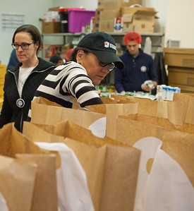 Secretary of Commerce Penny Pritzker serves at Food and Friends in NE Washington, D.C. on MLK Day 2014. Corporation for National and Community Service Photo.