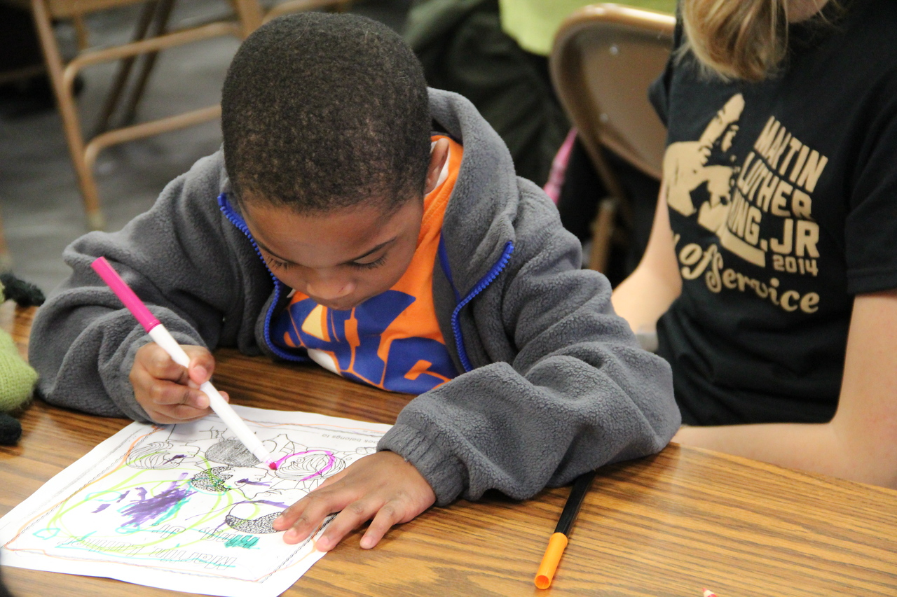 A young student draws during MLK Day 2014. Corporation for National and Community Service Photo.
