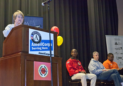 CNCS CEO Wendy Spencer speaks at Coolidge HS in Washington, D.C. during MLK Day 2014, flanked by a City Year AmeriCorps member and Secretary of Education Arne Duncan. Corporation for National and Community Service Photo.