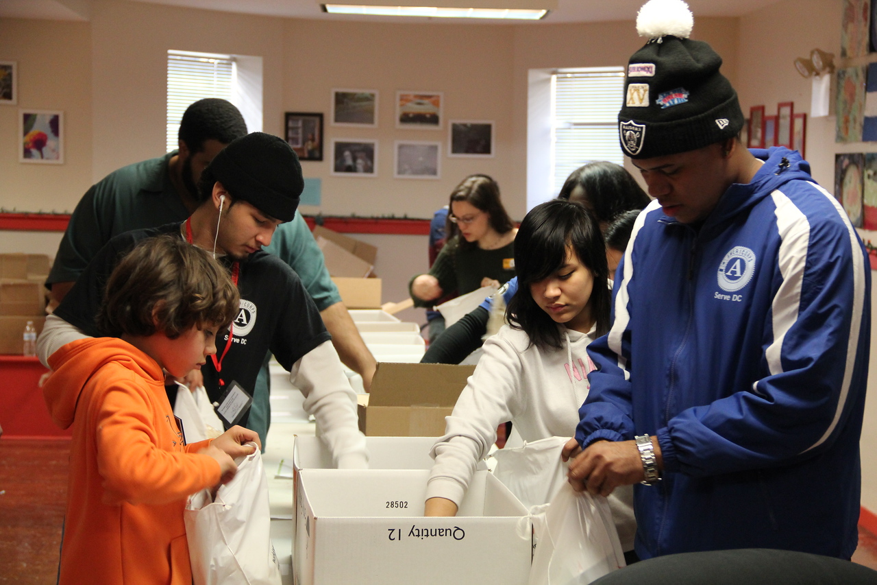 AmeriCorps members and community volunteers prepare hygiene kits for homeless youth at the Latin American Youth Center in Washington, D.C. on MLK Day 2014. Corporation for National and Community Service Photo.