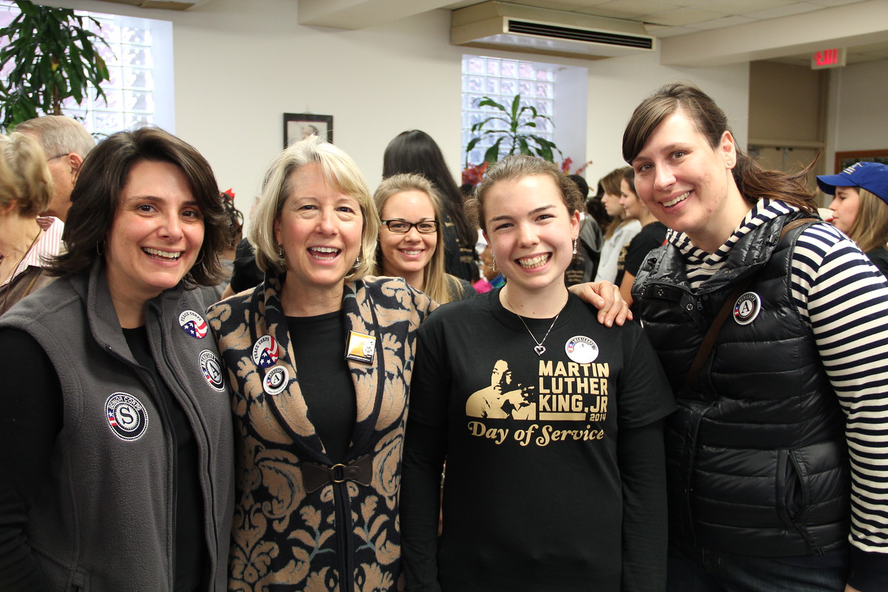 CNCS General Counsel Valerie Green, Acting Director of the Peace Corps Carrie Hessler-Radelet, an AmeriCorps VISTA member, and CNCS CEO Special Assistant Jenny Mauk enjoy MLK Day 2014. Corporation for National and Community Service Photo.