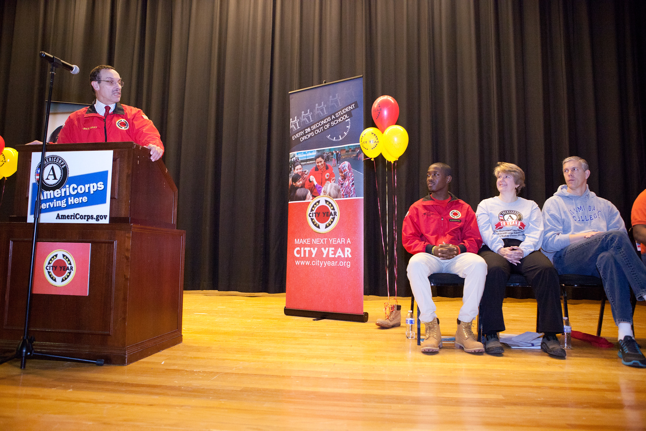 Mayor Vincent Gray speaks to volunteers, alongside CNCS CEO Wendy Spencer, City Year AmeriCorps members, and Secretary of Education Arne Duncan. Corporation for National and Community Service Photo.