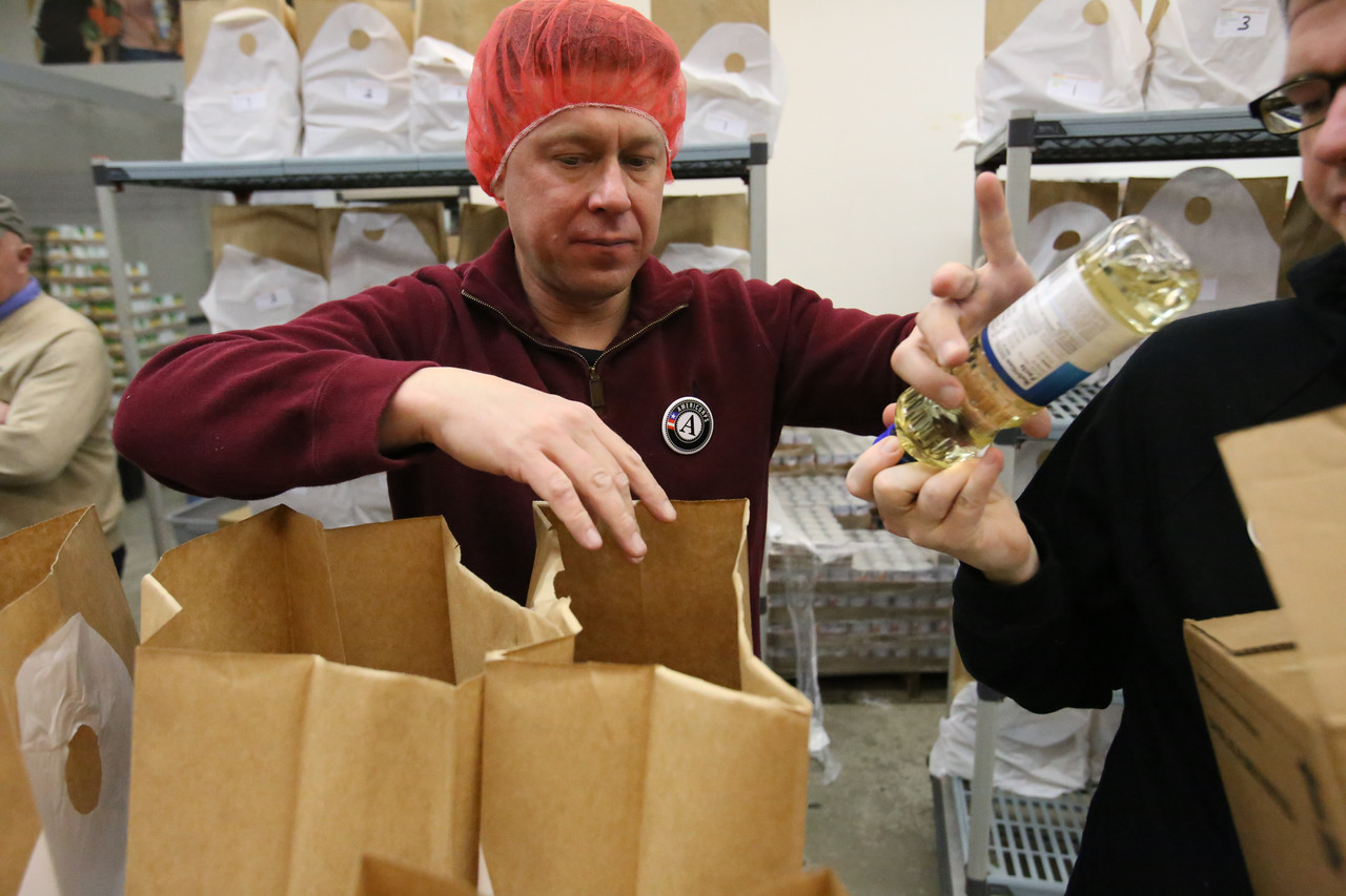 A volunteers serves at Food and Friends in NE Washington, D.C. during MLK Day 2014. Corporation for National and Community Service Photo.