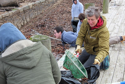 Secretary Sally Jewell of the Department of the Interior works alongside AmeriCorps NCCC members and community volunteers on MLK Day at an Anacostia river cleanup project organized by the Student Conservation Assocation, an AmeriCorps program. Corporation for National and Community Service photo.