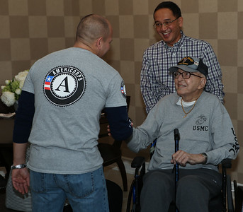 CNCS Veterans and Military Families Fellow Jon Lira meeting with a Korean War Veteran and Purple Heart recipient at the Fisher House located at the Veterans Medical Center in Washington, D.C. on MLK Day of service. Corporation for National and Community Service photo