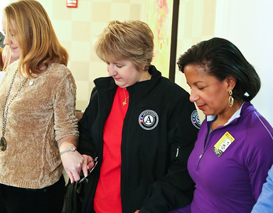 CNCS CEO Wendy Spencer and United States National Security Advisor Susan Rice pause for a prayer led by a purple heart recipient before a meal at the Fisher House located at the Veterans Medical Center in Washington, D.C. on MLK Day of service. Corporation for National and Community Service photo.