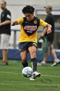 17 July 2010:   Club America #26 Defense Juan Silva brings the ball forward during the MLS Club America vs. San Luis FC game at Cowboys Stadium in Arlington, TX. Mandatory Credit: Manny Flores/Southcreek Global
