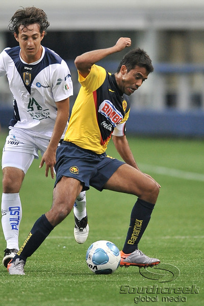 17 July 2010:  <br /> Club America #13 Pardo Pavel fights for a loose ball<br /> during the MLS Club America vs. San Luis FC game at Cowboys Stadium in Arlington, TX. Mandatory Credit: Manny Flores/Southcreek Global