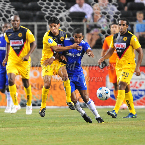 July 26 2009 World Football Challenge - Chelsea FC v Club America:<br />  #18 Angel Reyna of CA and #16 Scott Sinclair of FC in action at the Cowboys Stadium in Arlington, Texas.<br /> Chelsa FC beats Club America 2-0.