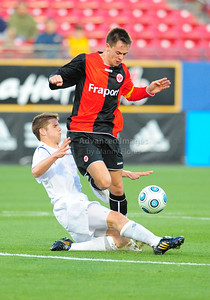 April 10th, 2009: Eintracht Frankfurt Mario Pokar #20 in action during a Super U19 semi-final game at the Dr. Pepper Dallas Cup between the Eintracht Frankfurt and the Vancouver Whitecaps  at the Pizza Hut Park Stadium in Frisco, Tx.