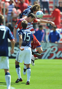 29, March 2009:   FC Dallas forward Kenny Cooper #33 & Chivas USA defender Carey Talley #12 in action during the soccer game between FC Dallas & Chivas USA at the Pizza Hut Stadium in Frisco,TX. Chivas USA  beat FC Dallas 2-0. Manny Flores/Icon SMI