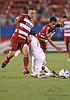 17 July 2010:  <br /> Real Salt Lake #17 D Chris Wingert gets tripped up<br /> during the game between Real Salt Lake and FC Dallas at the Pizza Hut Stadium in Frisco, TX. Mandatory Credit: Manny Flores/Southcreek Global