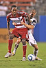 17 July 2010:  <br /> FC Dallas #16 F/M Atiba Harris fights for the ball as he is being held<br /> during the game between Real Salt Lake and FC Dallas at the Pizza Hut Stadium in Frisco, TX. Mandatory Credit: Manny Flores/Southcreek Global