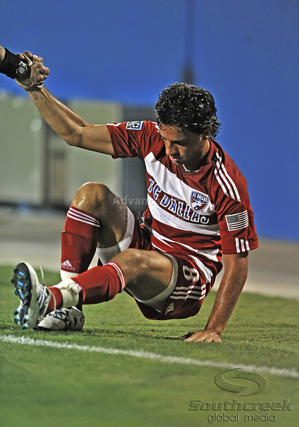 17 July 2010:  <br /> FC Dallas #8 M Bruno Guards helped up by official after being tripped up during the game between Real Salt Lake and FC Dallas at the Pizza Hut Stadium in Frisco, TX. Mandatory Credit: Manny Flores/Southcreek Global