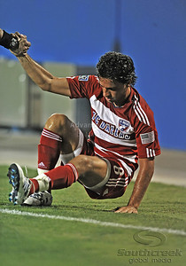 17 July 2010:   FC Dallas #8 M Bruno Guards helped up by official after being tripped up during the game between Real Salt Lake and FC Dallas at the Pizza Hut Stadium in Frisco, TX. Mandatory Credit: Manny Flores/Southcreek Global