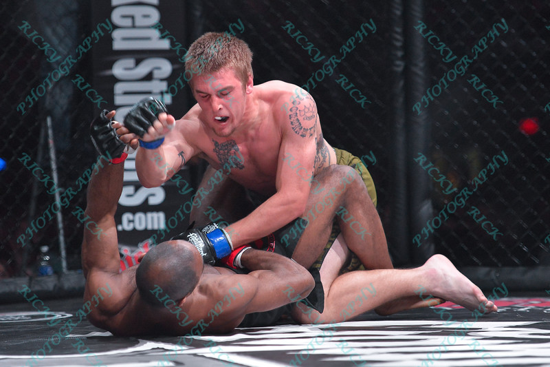 During the 8th match of the Mixed Martial Arts match between CODY HUFF (blue tape) and DEREK CLARDY (red tape) at the Fight Hard MMA held at the Family Arena in St. Charles MO.