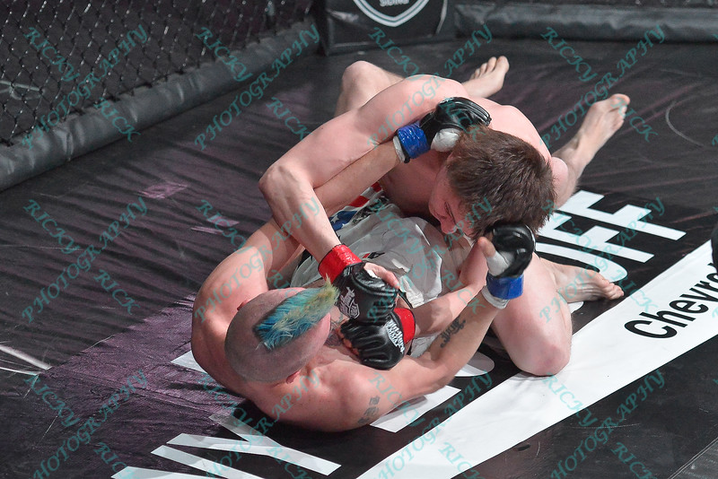 The third match of the Mixed Martial Arts match between JOE TAYLOR (blue tape) and ERIK NEWMAN (red tape) at the Fight Hard MMA held at the Family Arena in St. Charles MO.