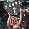 The ring girl shows it round two during the third match of the Mixed Martial Arts match at the Fight Hard MMA held at the Family Arena in St. Charles MO.