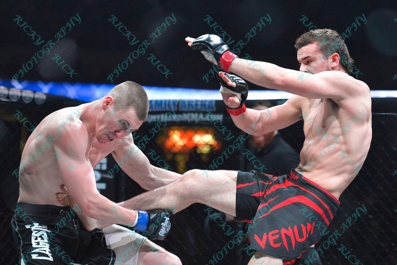 During the 9th fight of the Mixed Martial Arts match between JERADON BROWN (blue tape) and DAKOTA BUSH (red tape) at the Fight Hard MMA held at the Family Arena in St. Charles MO. where DAKOTA BUSH defeated JERADON BROWN
