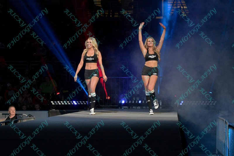 The ring girls make their way to to the ring during the Mixed Martial Arts match between  and  at the Fight Hard MMA held at the Family Arena in St. Charles MO.