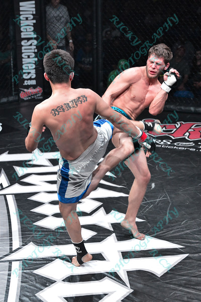 During the 5th fight of the night in the Mixed Martial Arts match between JAMES MOTTERSHED (white tape) and VI NGUYEN (red tape) at the Fight Hard MMA held at the Family Arena in St. Charles MO. where JAMES MOTTERSHED defeated VI NGUYEN.