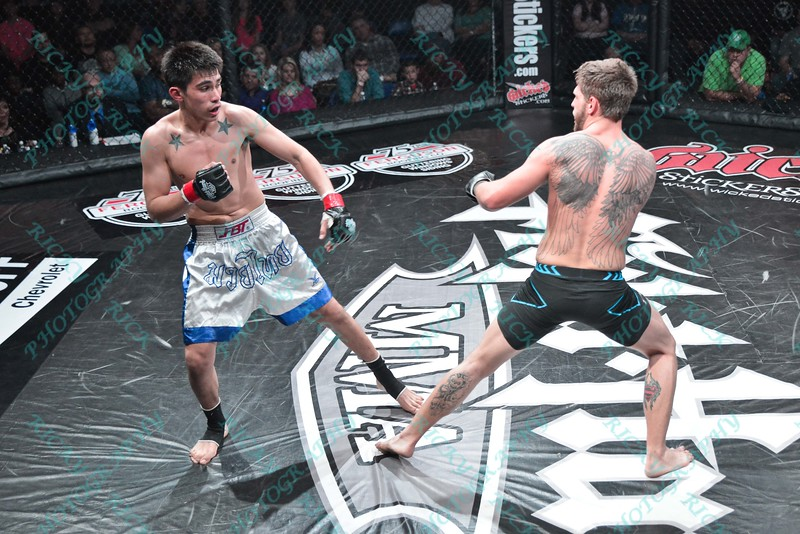 During the fifth match of the Mixed Martial Arts match between JAMES MOTTERSHED (white tape) and VI NGUYEN (red tape) and  at the Fight Hard MMA held at the Family Arena in St. Charles MO.