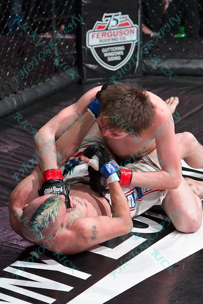 During the 3rd fight of the Mixed Martial Arts match between JOE TAYLOR (blue tape) and ERIK NEWMAN (red tape) at the Fight Hard MMA held at the Family Arena in St. Charles MO. where ERIK NEWMAN defeated JOE TAYLOR.