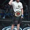DAN BUSCH poses with the championship belt after winning his match of the Mixed Martial Arts match at the Fight Hard MMA held at the Family Arena in St. Charles MO.